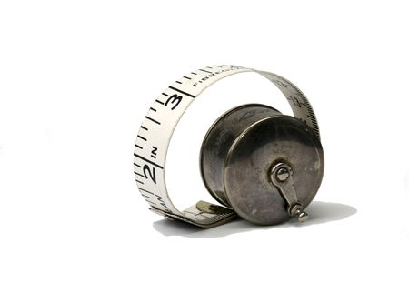 increment: measuring tape in antique silver holder Stock Photo