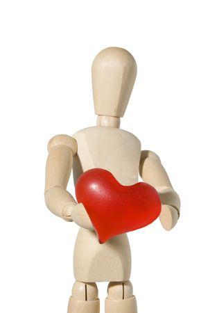 smooch: wooden mannequin presents red heart