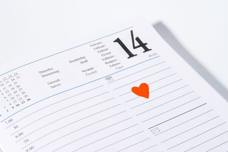 Diary open on february 14 with a heart painted on paper photo