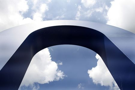 blue arch against a blue and white sky photo
