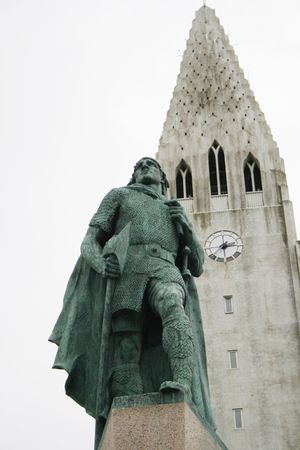 leif: Hallgrimskirkja Church in Reykjavik Iceland with statue of Leif Eriksson claimed to have discovered the Americas before Columbus Stock Photo