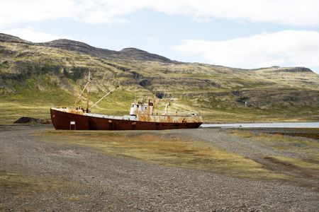 old rusted ship stranded on land photo
