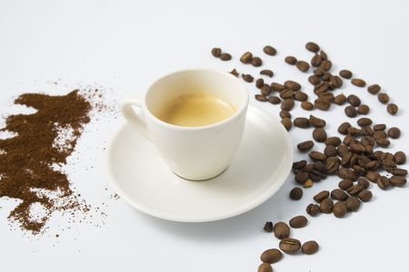 grained: espresso coffee in cup with beans and grained coffee Stock Photo