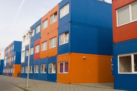 housing problems: colorful cargo containers are used for housing students in Amsterdam Stock Photo
