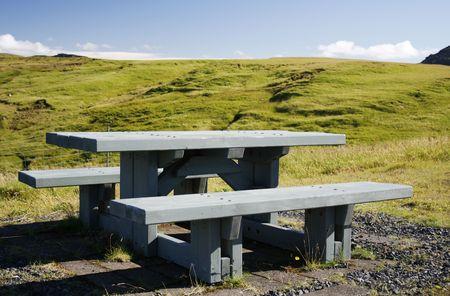 picknick: wooden picknick bench in green landscape in Iceland Stock Photo