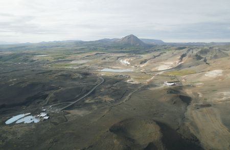 Myvatn area with pseudocraters and lagoon and thermal baths in Iceland Stock Photo - 2678854