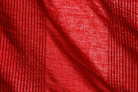 red cotton in close up with wrinkles photo