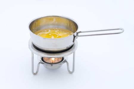 tealight: melting butter in a small pan on a tealight