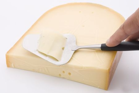 slicer: gouda cheese with slicer Stock Photo