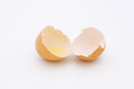 residue: broken eggshells on white with eggwhite residue in one shell