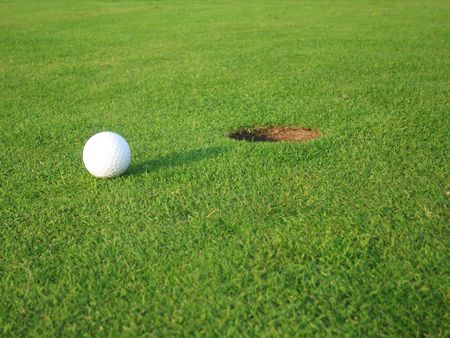 Golf green with ball near hole Stock Photo - 3085879