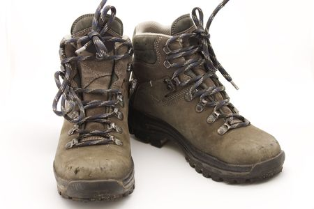 sturdy: Pair of sturdy used hiking boots on white background Stock Photo