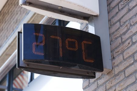celsius: sign on wall indicating 27 degrees celsius