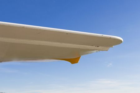 airplane ultralight: wing of ultralight airplane in close up against a blue sky
