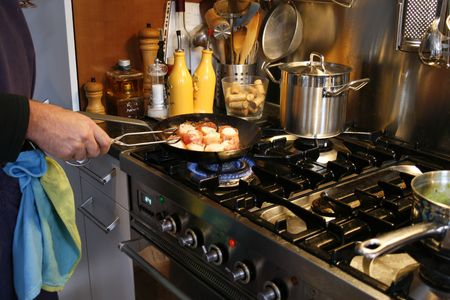 gas stove: cooking, cuisine, culinary, food, gas, home, kitchen, ladle, making, man, meal, oven,  prepare,  Stock Photo