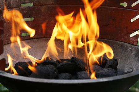 backyards: Barbecue charcoal with flames Stock Photo