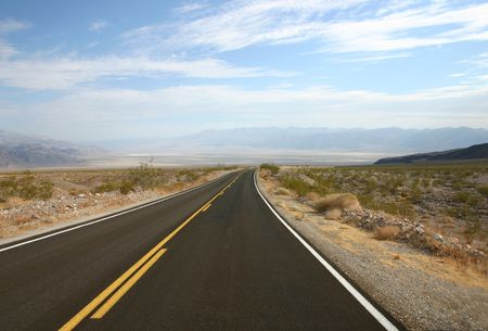 death valley: Empty highway in Death Valley in USA Stock Photo