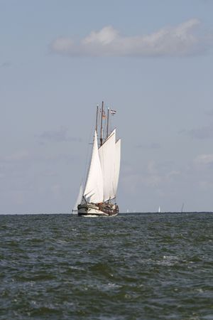 Typical Dutch old sailing ship on ocean photo