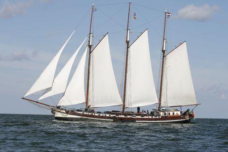 Typical old Dutch three mast sailing boat on sea