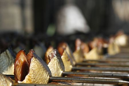 kipper: Delicious Dutch smoked herring on skewers Stock Photo