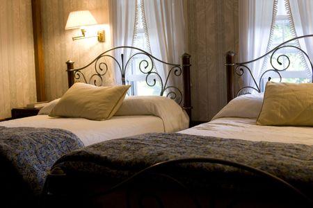 Two queen beds in classic bedroom photo
