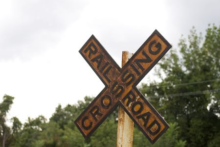 wood railroads: close up of old railroad crossing sign Stock Photo