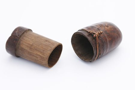 Antique wooden Indonesian sirih (or betel) container. Sirih leafs are usually used to chew on and are considered a medicine to make the teeth stronger but it is very addictive and makes teeth black. Stock Photo