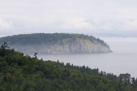 Coastline of Arcadia National Park in early morning mist photo