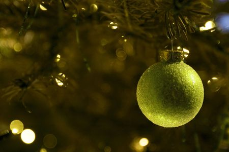 Holiday background with green christmas ball photo