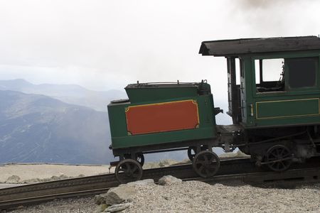return trip: The cog train up Mount Washington is one of the steepest railways and the first (1869) mountain climbing railway in existence. The locomotive uses 1000 kilos of coals for the return trip up and down Mount Washington. Stock Photo