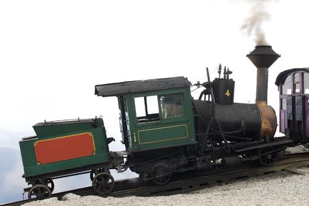 kilos: The cog train up Mount Washington is one of the steepest railways and the first (1869) mountain climbing railway in existence. The locomotive uses 1000 kilos of coals for the return trip up and down Mount Washington. Stock Photo