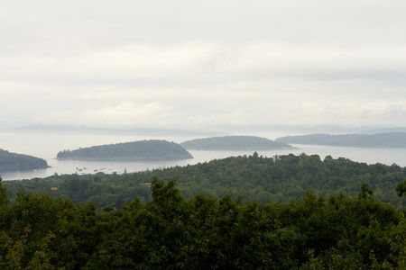 early fog: Three islands in early fog at Arcadia National Park in Maine