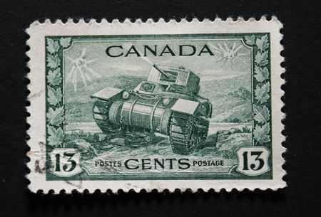 frayed: Old Canadian postage stamp with image of a tank Stock Photo
