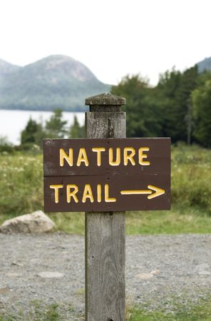 outdoor pursuit: Wooden post with sign and text: nature trail and arrow