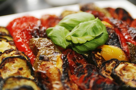 Close up of delicious grilled vegetables with a green basil leaf on top with little depth of field Stock Photo - 3947353