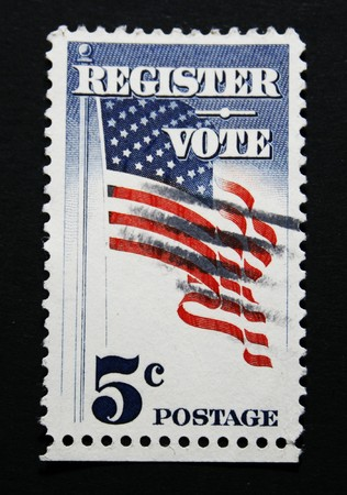 American postage stamp with text: register to vote. photo