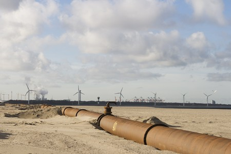 Pipeline on beach with view on industry area in background Stock Photo - 4048043