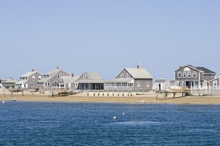 Wooden sea side houses on the beach at Cape Cod Stock Photo