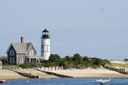 cod: Wooden house and white lighthouse at Cape Cod near Portland