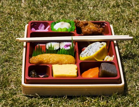 bento: Assorted japanese lunchbox with chopsticks