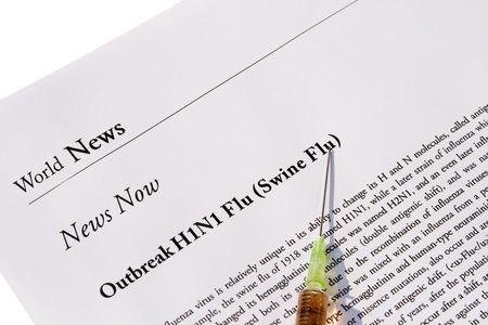 outbreak: Newspaper headline about outbreak of swine flu with syringe Stock Photo