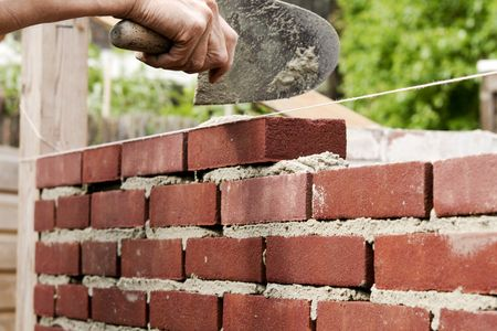 Bricklayer on construction site
