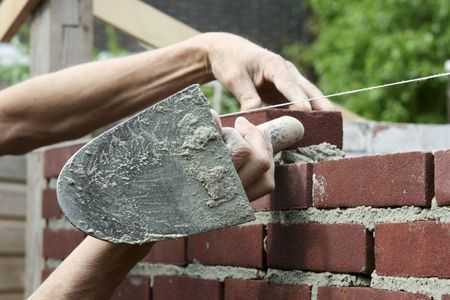 bricklayer: Bricklayer at work with