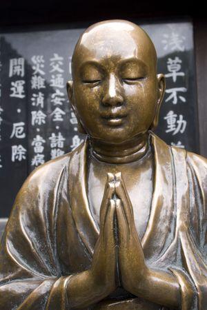 Beautiful copper Buddha statue at a shrine near Senso-ji Temple, Asakusa, Tokyo, Japan photo