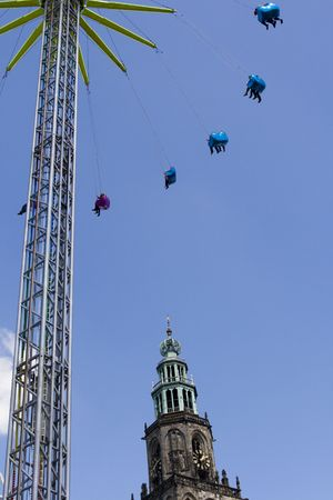 chairoplane: Chainswing ride high up in the sky of Groningen town Stock Photo