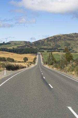 Empty asphalt highway through nature in New Zealand Stock Photo - 4870773