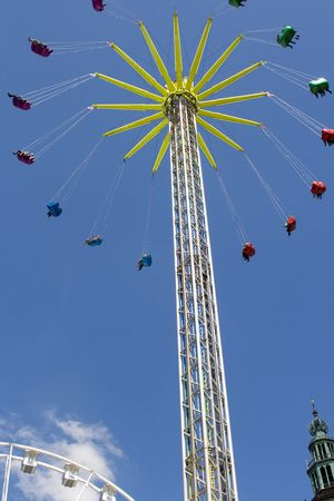 chairoplane: Colorful chain swing in center of town  Stock Photo