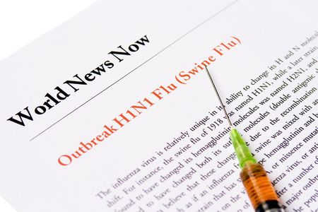 Newspaper headline about outbreak swine flu with syringe filled with antivirus 