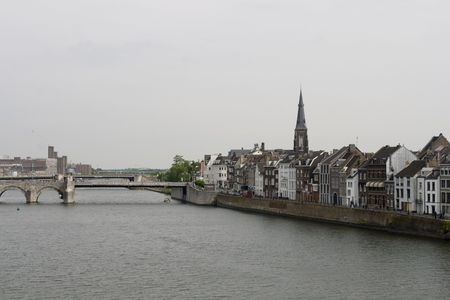 meuse: Medieval Servatius bridge and houses on quai of Meuse