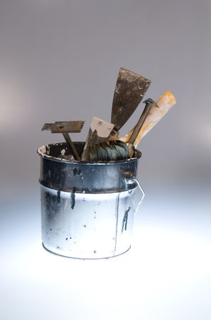 Metal bucket with tools and paintbrushes with blue light Stock Photo - 5094323